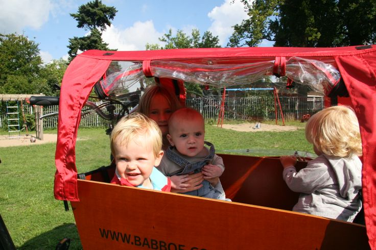 A raintent protects your children from the rain when they are in the Babboe cargo bike