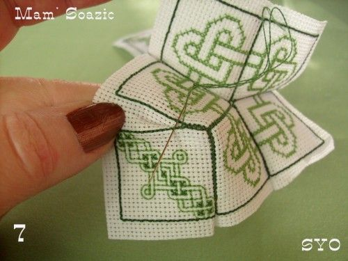 15 face biscornu, Celtic hearts & knots not in English, but step by step instructions and pattern.