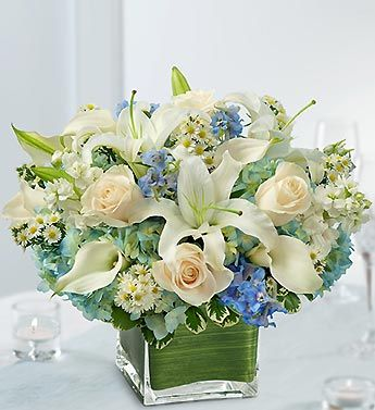 Fresh blue delphinium, blue hydrangea, white roses, white lilies