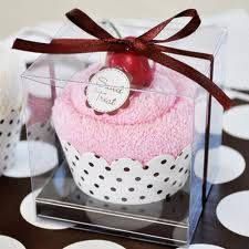 I totally want to do this for the bridal shower. washcloth cupcake favors...easy and adorable