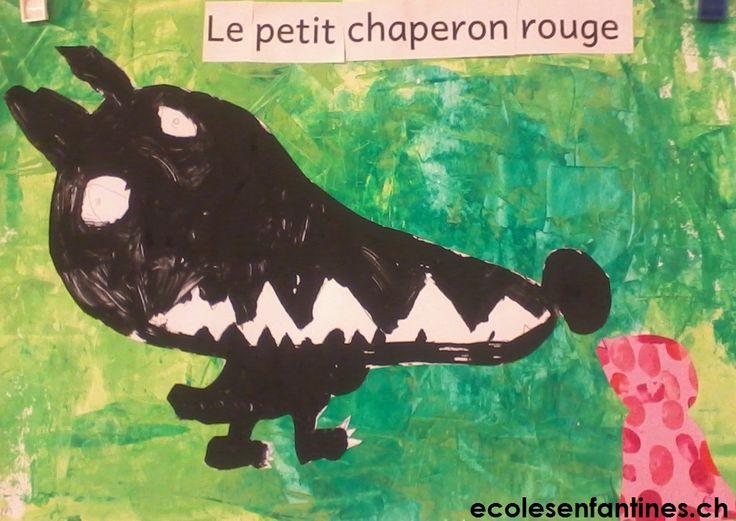 """Le dessin du loup : chaque enfant à reçu une grande feuille sur laquelle était dessiné une forme de tête allongée. En racontant une partie de l'histoire du petit chaperon rouge, chacun a ajouté """"Mère-grand, que vous avez de grandes oreilles!"""", """"Mère-grand, que vous avez de grands yeux!"""""""