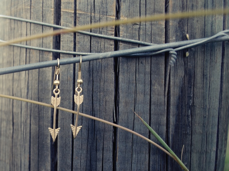 arrow earrings available at www.knotandfeather.com Rings, bracelets, studs, spikes, necklaces,earrings, gold, silver, cuffs, arrows, gems, crystals.... We have it all!