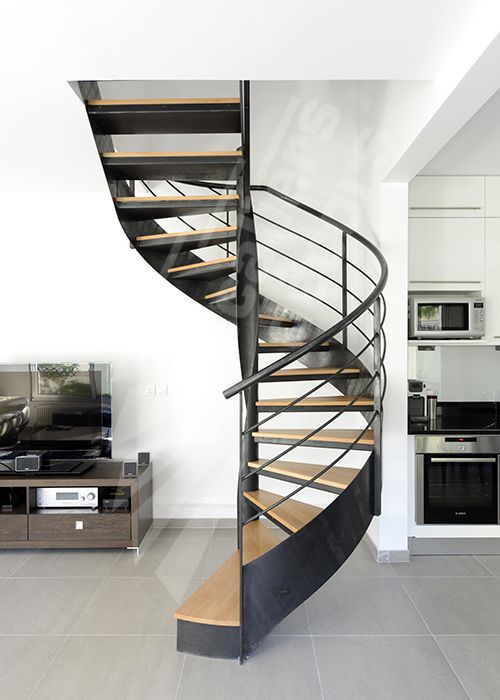 Escalier d 39 int rieur m tallique design sur flamme centrale formant escali - Escalier metallique design ...
