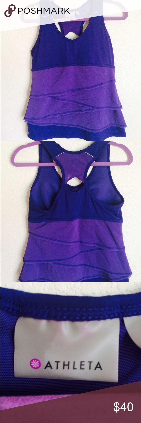 Athleta yoga top You thought that hot yoga teacher was smiling at you before? Well once you walk into the studio wearing this beautiful purple athletic top, he won't be able to keep his eyes off of you! It has only been worn once, and is in great shape, just like you will be once you make an offer. What are you waiting for? Yoga starts soon! Built in bra, sheer ruffles and razor back. Athleta Tops Tank Tops