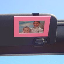 Take along your favorite picture with a Pink Car Visor Frame. Clips to the car visor and holds a wallet size photo. Available at CarDecor.com.