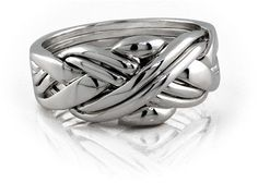 Puzzle ring.  I want one so bad.  I used to have one and then lost it as a teenager...