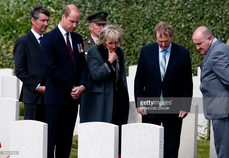 Britain's Prince William, Duke of Cambridge, Princess Astrid of Belgium and Irish Prime Minister Enda Kenny look at tombstones as they arrive to attend a wreath-laying ceremony during the Battle of Messines Ridge commemorations at the military cemetery in Wijtschate, Belgium, on June 7, 2017. The Battle of Messines took place June 7-14, 1917 and was an offensive conducted by the British Second Army, during the First World War. LENOIR