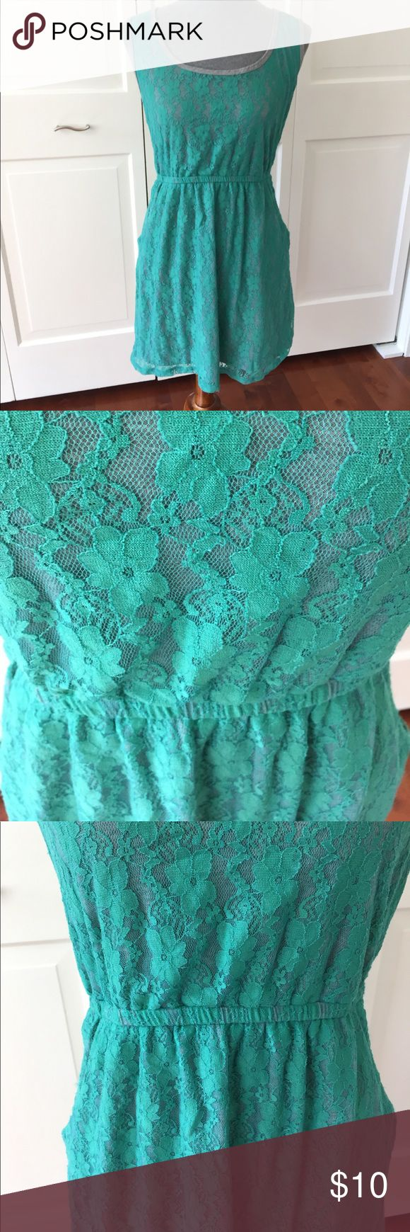 Vanity green lace dress with pockets This dress from Vanity has green lace on the outside and a grey terry cloth lining. It has elastic as the waist and pockets!! Vanity Dresses