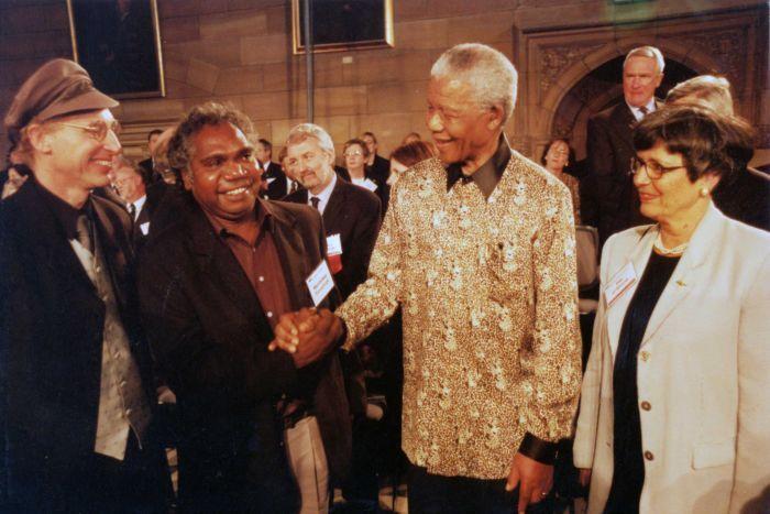 Mandawuy Yunupingu meets Nelson Mandela. (Image courtesy Yothu Yindi and Mushroom Records)