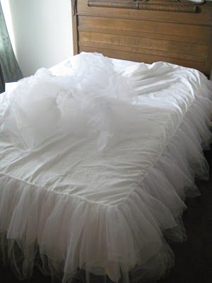 tulle bedskirt--i think it would be cute on a crib if you could make it safe enough.