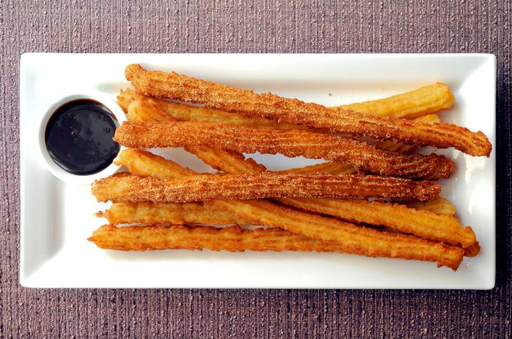 How To Make Churros Recipe with Chocolate Sauce - Caribbean Food How To Make Churros Recipe with Chocolate Sauce - Caribbean Food If you are not familiar churros, they are one of the best Spanish desserts ever.  At vendors, people actually wait in line for hours to get just one of these tasty treats. A Churros recipe is like a fritter, but only better