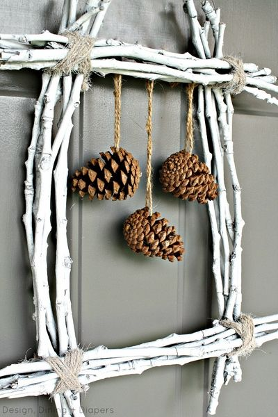 Painted twig and pine cone wall decor