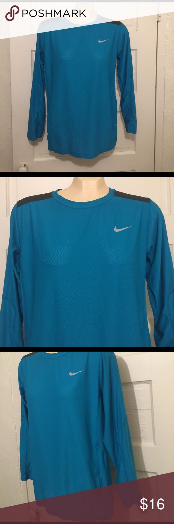 NIKE DRI- FIT WOMENS RUNNING TOP SIZE - XL NIKE DRI- FIT Women's Running Top * SIZE - XL  * Color - Turquoise * Long Sleeve  * Open boat neck Nike Dri-FIT Cool Breeze Women's Running Top keeps you dry, cool, and comfortable with super lightweight Dri-FIT fabric.  IN EXCELLENT CONDITION! Nike Tops