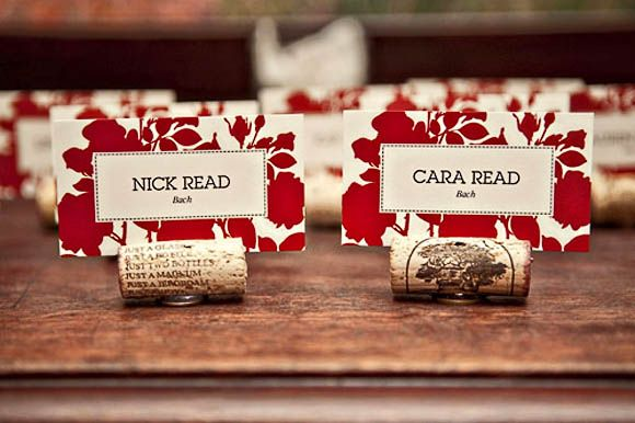 Cork Table Place Card Holder - Slit the top of the cork and hot glue a nickle or washer on the bottom for stability.