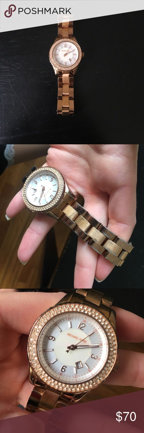 Michael Kors watch Rose gold watch with diamonds around the face of the watch. Very minimal wear and tear (see photos). Needs a replacement battery but it is in great working condition! Have extra pieces to adjust it to your size. Michael Kors Accessories Watches