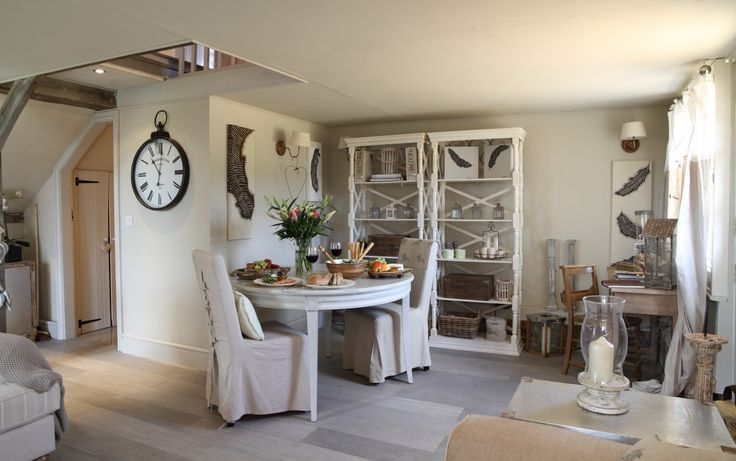 SHROPSHIRE: Turtledove Hideaway, luxury self-catering from www.uniquehomestays.com. Stylish cottage dining area in ivory and various other pale to dark neutrals, accessorised with an eclectic mix of rustic, classic and vintage objects.  Keeping it neutral creates space whilst being a relaxing colour scheme to live with.