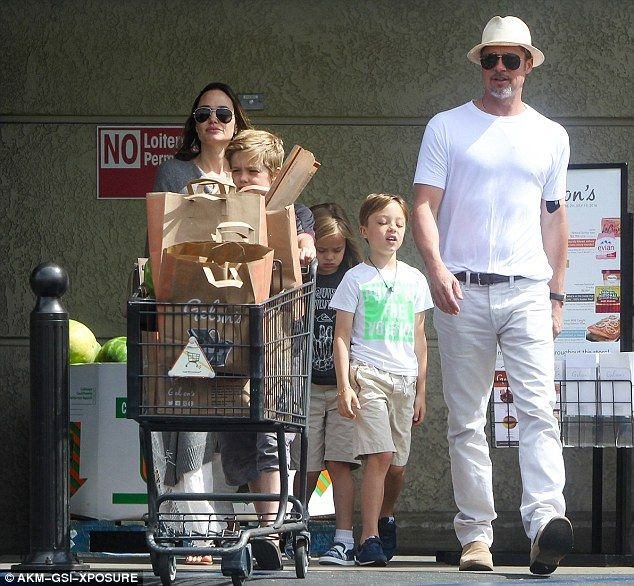 Grabbing supplies: Angelina Jolie and Brad Pitt took daughter Shilo, 10, and twins Vivienne and Knox, seven, to the grocery store on July 4 to pick up food for their Independence Day celebration