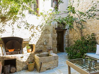 Rethymno villa rental - BBQ facilities and traditional wood oven at the garden!