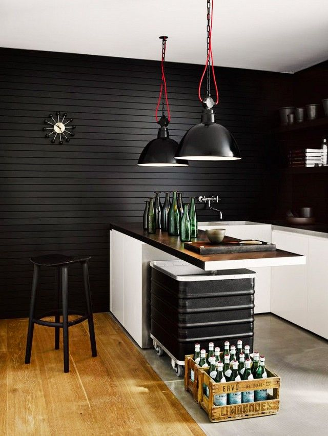 Modern industrial kitchen with black elements.