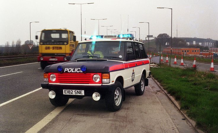 A Greater Manchester Police Range Rover attends the scene of an incident near Barton Bridge in 1988.
