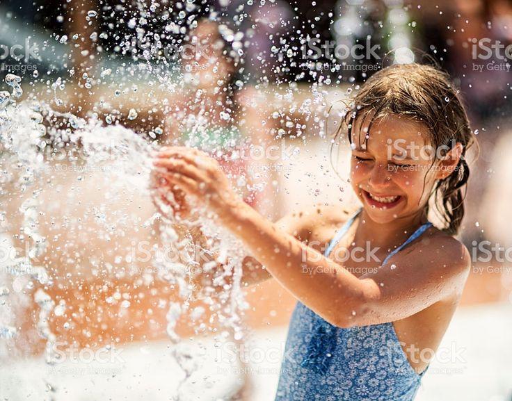 Little girl having fun in water park fountain royalty-free stock photo