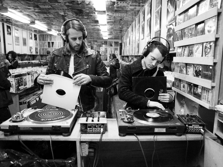 PHOTO: Zach Cowie, left, and Elijah Wood, right, try out vinyl records in A1 Records in New York City on Jan. 19, 2015.