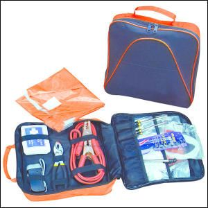 """Car Safety Kit-600D Polyester carry case contains 8"""" pliers, 12 gauge booster cables, first aid kit, two screwdrivers, tire gauge, gloves, thermal blanket, safety matches, candles, safety triangle, electrical tape, fuses, siphon pump, hand press flashlight, safety vest and light sticks. All contents polybagged and inside of carry case."""
