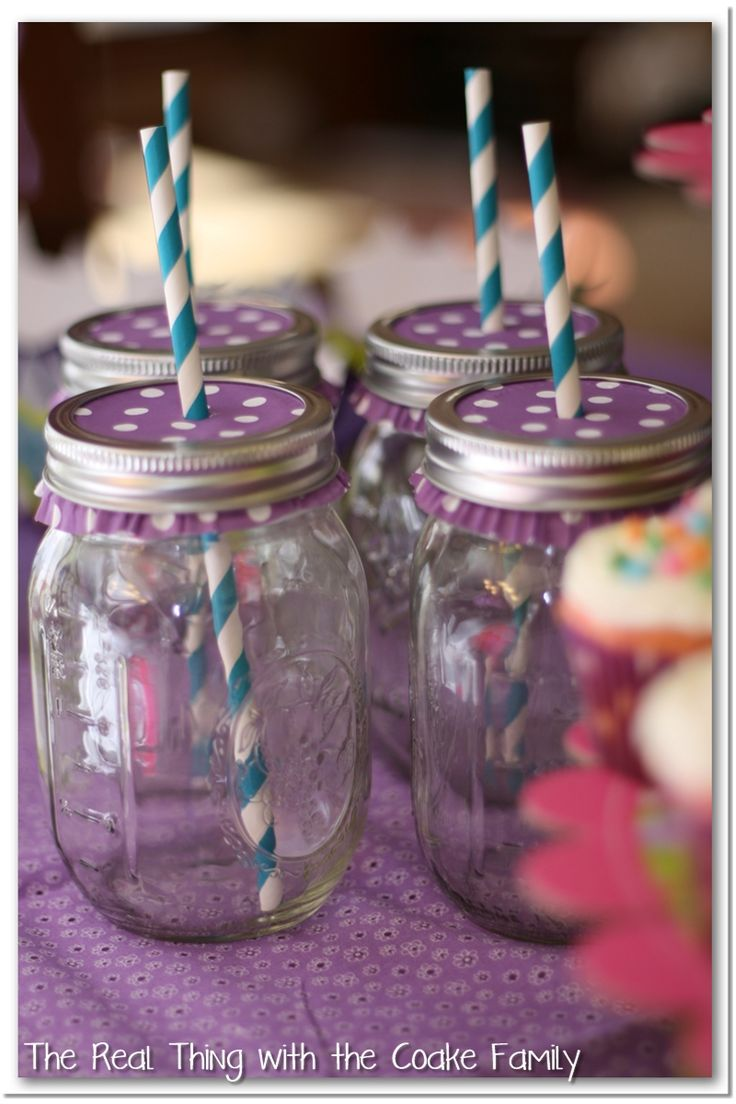 Use cupcake liners to cover the tops then poke a hole for straw on the top. Reusable and changeable for different party themes!