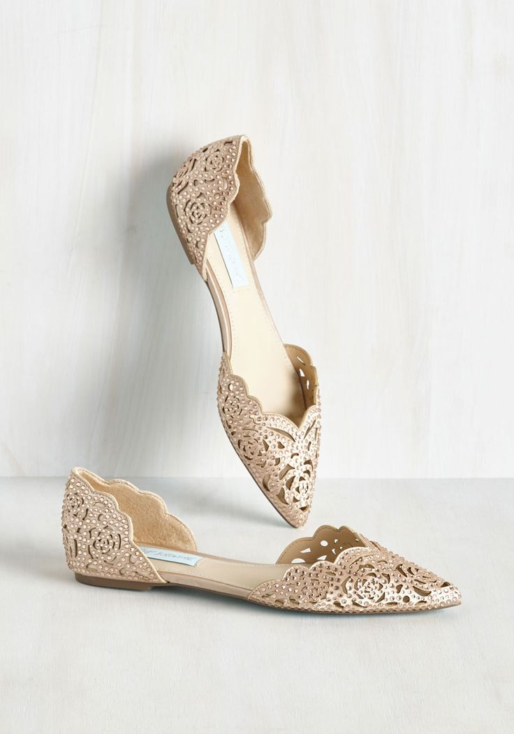 Sashaying to your seat in these opulent flats by Betsey Johnson, your luxe look gives this fine dining experience extra stars. Glistening with blush pink rhinestones atop beige satin, this posh pair continues to wow with pointed toes, scalloped edges, and rose-shaped cutouts.