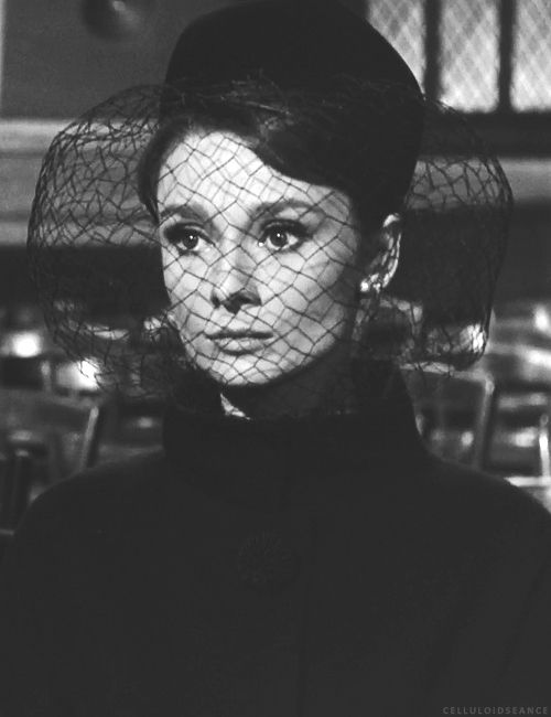 """Charade""1963. Widow Audrey Hepburn at her husband's very poorly attended funeral."