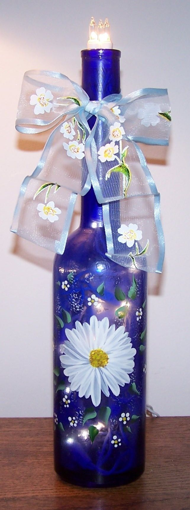 Bottle with interior lights can be painted with glass for Painting flowers on wine bottles