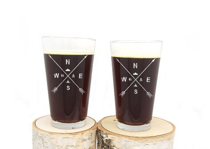 Pint Glasses - Arrow & Wilderness Compass - Screen Printed Glassware Set. These nature themed glasses feature a detailed screen print of our arrow compass. Showcasing two crossed arrows, some rustic lettering, along with a tent, campfire, tree and mountain illustration in the center! Great for beer, or just an everyday kitchen glass! Glasses manufactured in the USA. Printed by hand in our studio here in Denver, Colorado. White Ink. Ink is permanent and heat set in oven.Prints will not…