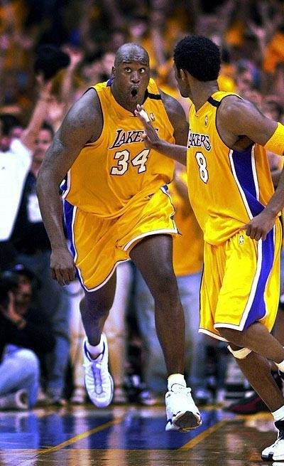 Shaq reacts after slamming home and securing the Dynamic Duo's first trip to the NBA Finals. Copyrights may apply. All rights reserved.