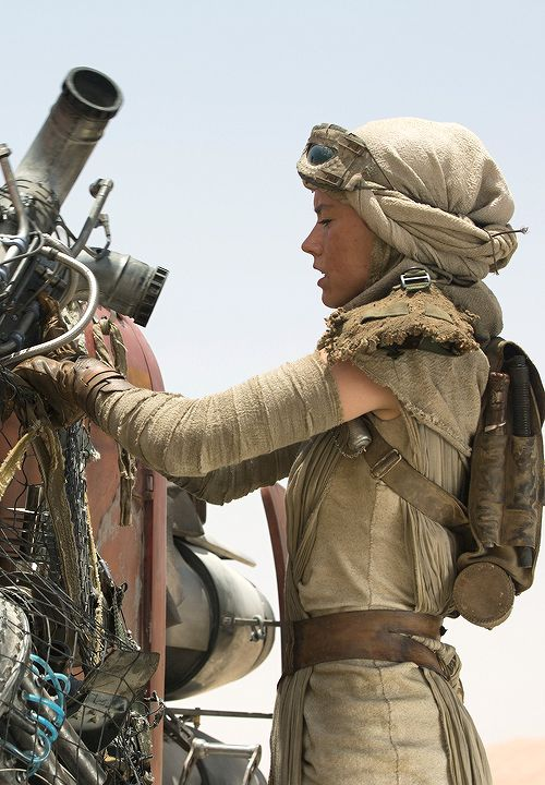 Star Wars VII: The Force Awakens. Rey played by Daisy Ridley with her speeder.