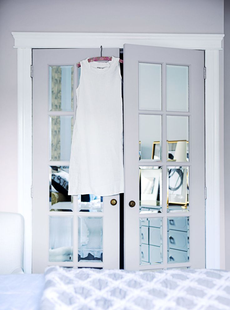 Dress up French doors by gluing on precut mirrors (found at craft and hardware stores), as seen in this Montreal apartment designed by Nicola Marc. Finish with a fresh coat of paint.