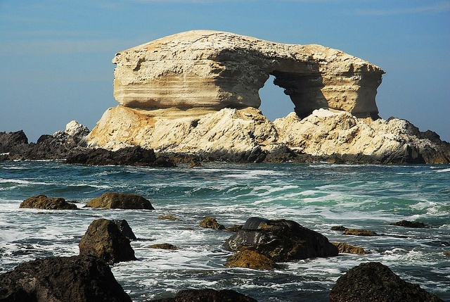 La Portada - Chile - South America - Protected by a firm foundation of erosion -resistant volcanic rock, the huge natural arch withstands the attack of the waves.