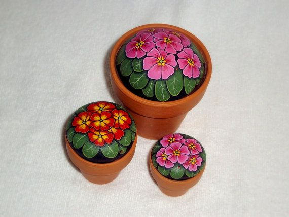 Pretty bright and cheery pink potted primrose hand painted rock, painted on a rounded beach stone that just fits the clay pot. A maintenance free spring garden for your office desktop or kitchen windowsill. A great gift for friends, coworkers or just a gift for her.    Did you spot the tiny ladybug hidden in the foliage?    NOTE: This listing includes one primrose painted rock only, the largest pink primrose top center. This listing DOES include the clay pot as seen in the photo.    Primrose…