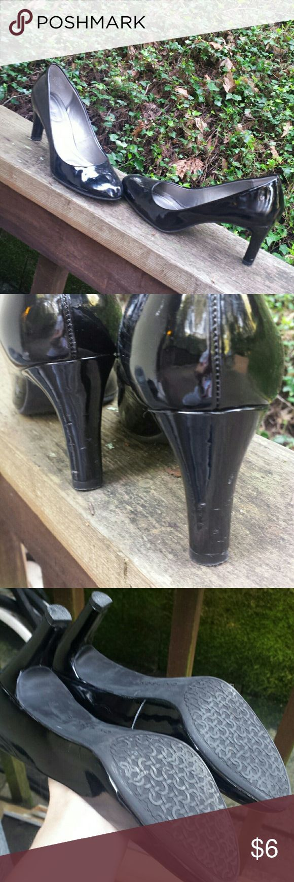 """Bandolino Patent Leather Pumps Black patent leather pumps.  Heel measures at 2 1/2"""".  Super comfortable  (Bandolino B Flexible). Heels are a little scuffed,  rest of shoes in pretty good condition. Bandolino Shoes Heels"""