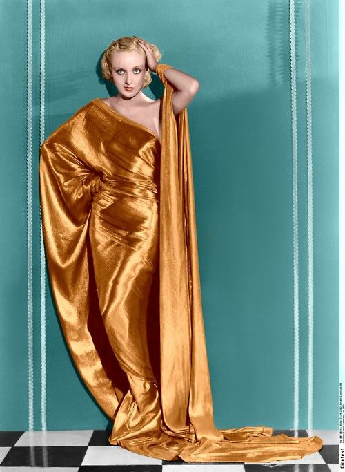 One shouldered 1930s gown in stunning gold shade- love contrast with background aqua/teal colour.