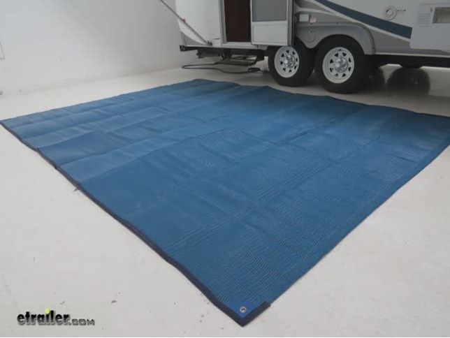 Lay this reversible, blue mat next to your RV to help keep dirt outside and provide a comfortable place to lounge. Woven material is tough and durable and lets rain pass through. Included ground stakes secure the mat. Lowest Prices for the best patio accessories from Camco. Camco Reversible RV Leisure Mat w/ Stakes - 12' Long x 9' Wide - Blue part number CAM42821 can be ordered online at etrailer.com or call 800-298-8924 for expert service.