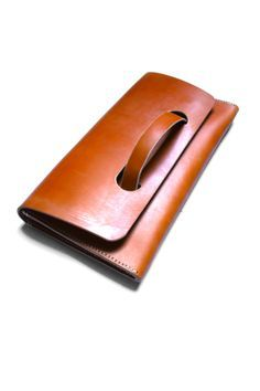 Leather clutch. this color is so beautiful and I love the Handle it has to hold the clutch. adorable 6.7.15