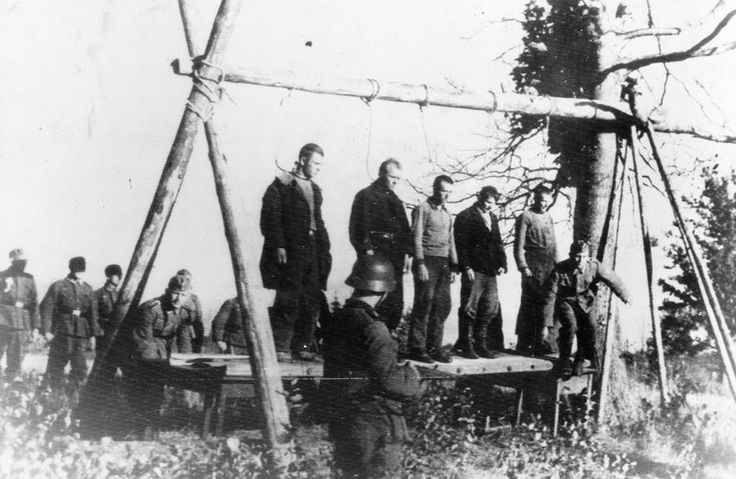 World War II: Operation Barbarossa - Five Soviet civilians on a platform, with nooses around their necks, about to be hanged by German soldiers, near the town of Velizh in the Smolensk region, in September of 1941.