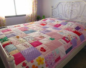 Big girl bed with baby clothes quilt made from the first 3 years of clothes, plus minky to make it cozy & fuzzy! JellyBeanQuilts.com #babyclothesquilt