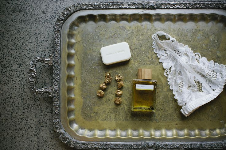 THE DETAILS: Earrings by Love and Object, scented soap bar by Ingrid Starnes, face oil by Martina Organics, lingerie by Lonely.
