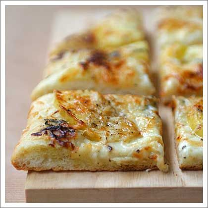 Pizza with taleggio ( a kind of smear cheese), apple, pecorino, sage and honey