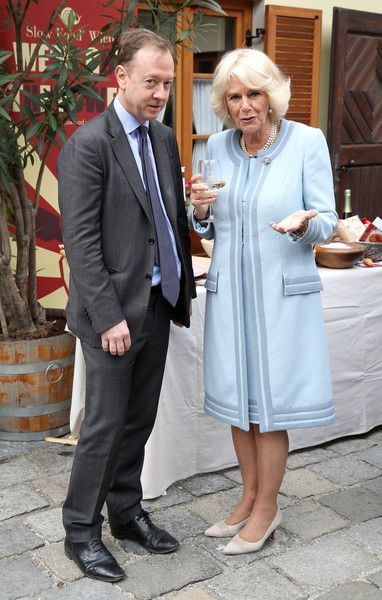 """Camilla Parker Bowles Photos Photos - Camilla, Duchess of Cornwall speaks with George """"Geordie"""" Greig, editor of The Mail on Sunday during a visit to the Weinbau Buscheschank Obermann vineyard on April 6, 2017 in Vienna, Austria. Their Royal Highnesses will tour the vineyard, wine cellar and the old wine press, and will view a selection of historical documents and an art exhibition. - The Prince Of Wales And Duchess Of Cornwall Visit Austria - Day 2"""