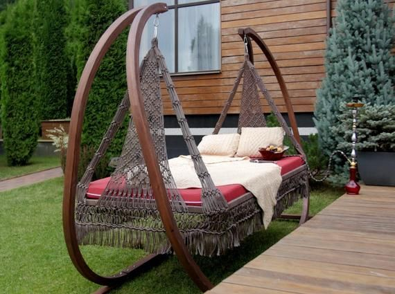 double swing bed with wooden stand in