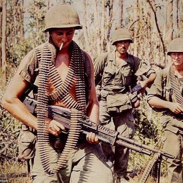 This picture shows how the USA soldiers looked when they were fighting in Vietnam. The guy without his shirt on is showing how hot it really was there and how different the climate and terrain was compared to what our military guys were used to training in.