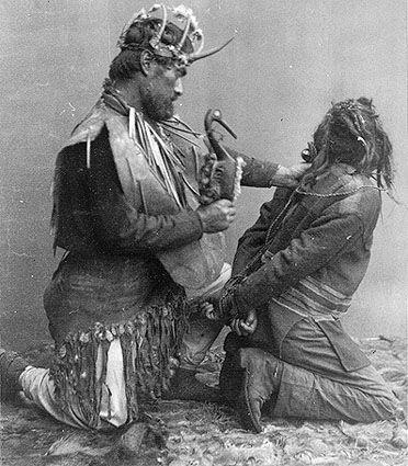 Tlingit shaman tying up a witch, Sitka, Alaska.