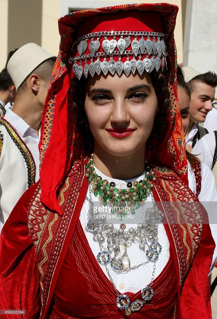 An Albanian dancer, in traditional costume, waits for the start of a performance to mark the country's National Cultural Heritage Day and European Heritage Day, in the capital Tirana, on September 29, 2014. Each year, the 50 signatory States to the European Cultural Convention take part in the European Heritage Days.
